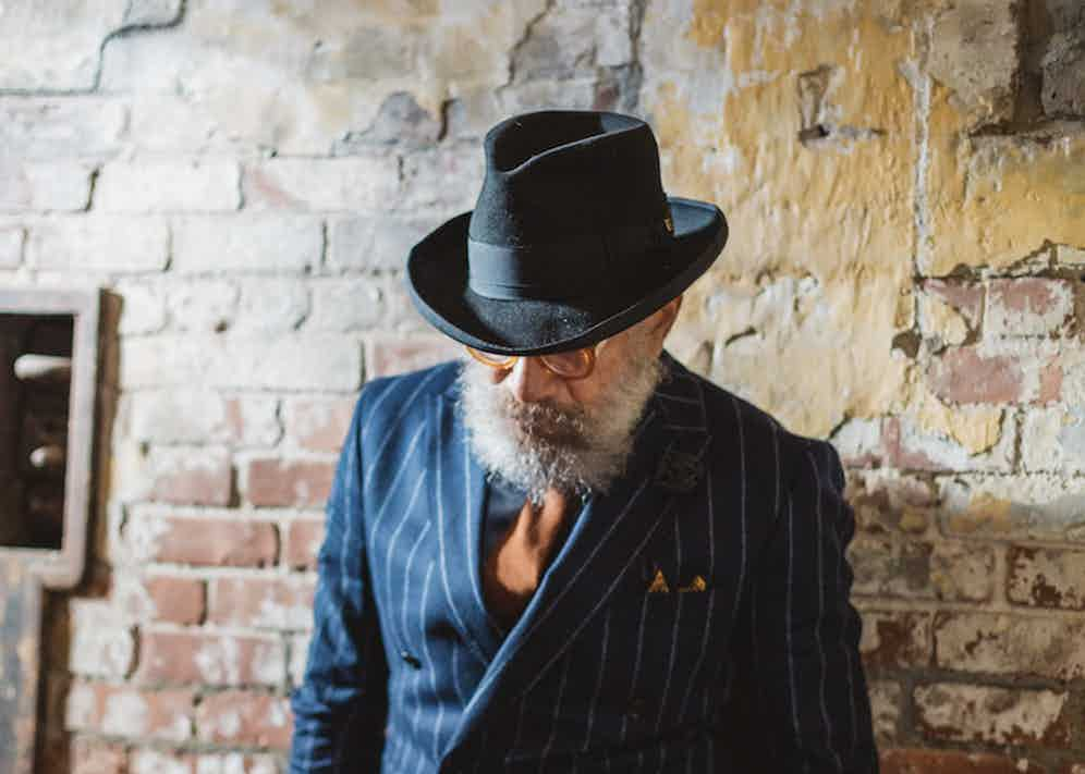 """""""I love English tailoring, Italian brands, Neapolitan cuts and classic American styles. I drift between periods,"""" Quiles says of his eclectic style. His hat is a rolled-brim fedora, crafted by Barbisio."""