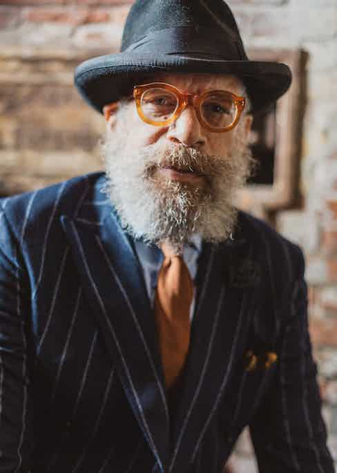 Ignacio's unconventional spectacles are vintage, from 1940s France. The thick acetate frames complement the warm tones of his tie and pocket square.