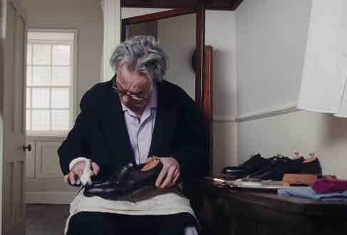 Day-Lewis' character polishes his bespoke Oxford shoes made by George Cleverley as part of his morning routine.