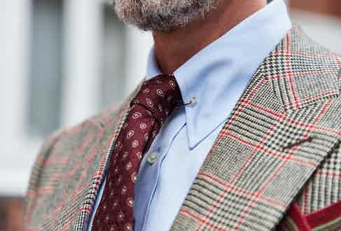 Edward Sexton's burgundy paisley silk tie is unlined but gets its volume from a seven-fold construction, which is slip-stitched throughout to allow for flexibility while wearing, and creates a perfect dimple at the knot. Photograph by James Munro.