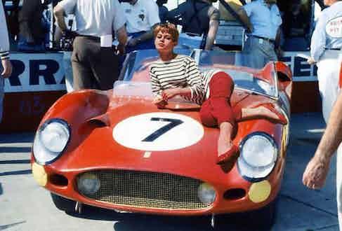 Brigitte Bardot wears a Breton shirt while reclining on a Ferrari, 1960.