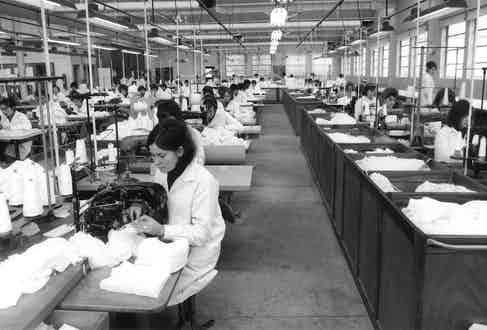 Workers in the factory after a shortage of raw materials during World War II, circa 1946.