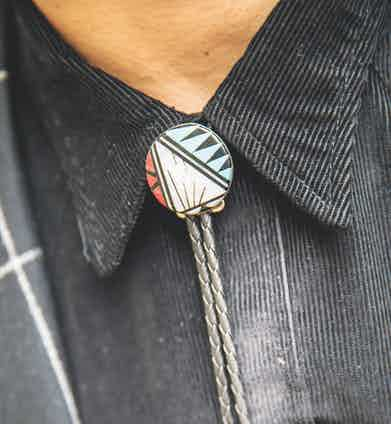 """Handmade bolo tie. """"I bought this from a Native American artisan in Monument Valley,"""" says Sergio. The corduroy western shirt that lies beneath, by the way, is by Barbanera."""