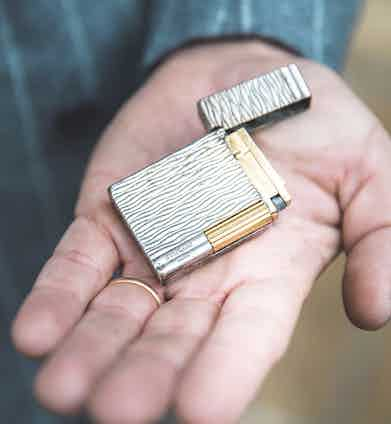 """The lighter is the French manufacturer S.T. Dupont's Gatsby, a limited-edition model made in 1999 from yellow-gold and silver. """"I got it for a Christmas present from a very good friend of mine in 1999 after winning a bet,"""" Sebastiano says."""