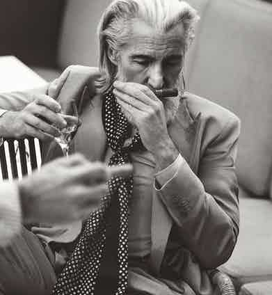 Aiden Brady wears beige double-breasted jacket and trousers, Bottega Veneta; silk striped shirt, Caruso; silk polkadot print scarf, John Varvatos. Photograph by Simon Lipman. Styling by Jo Grzeszczuk.