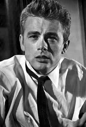 James Dean's tie is pulled askew in his typically rebellious fashion on the set of Rebel Without a Cause, 1955.