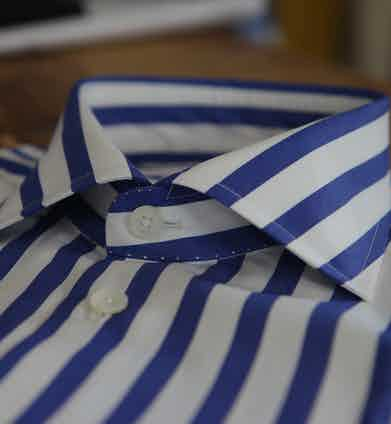 A blue and white bengal stripe cotton shirt with mother of pearl buttons.