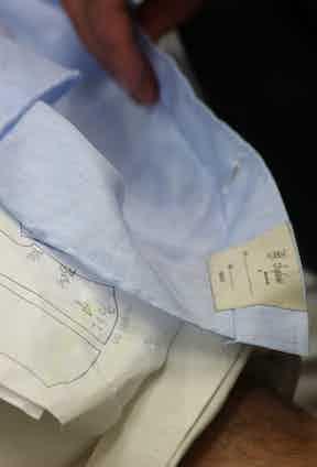 A light blue shirt under construction in the workshop.