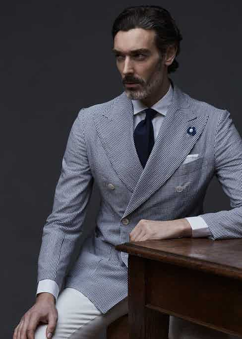 Navy and white seersucker cotton blazer, white shirt and navy silk tie, G. Inglese. Styling by Jo Grzeszczuk, photograph by Olivier Barjolle.