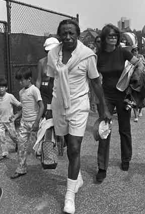 Wearing a polo shirt, shorts, tennis trainers and a knitted jumper hung casually around his neck, Parks plays tennis at Forest Hills Stadium in New York to benefit the RFK Memorial Foundation, 1972. Photograph by Pierre Schermann/Penske Media/REX/Shutterstock.