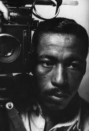 Parks' self-portrait using a vintage flash bulb camera, 1946.