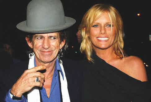 Even aged 75, Richards displays a quirky style wearing an oversized bowler hat with a generous dashing of silver jewelry. Pictured here with his wife Patti Hansen in New York, 2003. Photograph by REX/Shutterstock.