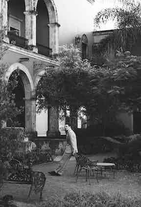 Windowpane check double-breasted suit, Richard James; cotton shirt, Salle Privée; Oxford shoes, Berluti.