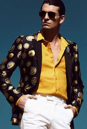 Cotton and silk jacket, Dolce & Gabbana; linen shirt, Vilebrequin; trousers, Gieves & Hawkes; aviator 1937 sunglasses, Ray-Ban.