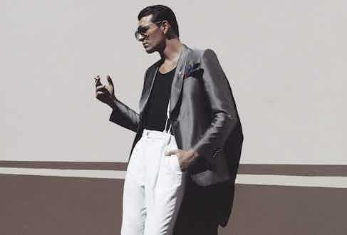 Silk evening jacket, Gieves & Hawkes; vest, Dolce & Gabbana; pleat front trousers, Caruso; silk braces, Albert Thurston for The Rake; silk pocket-handkerchief, Serà Fine Silk at The Rake; Cash boots, Barbanera at The Rake; aviator sunglasses, Ray-Ban.