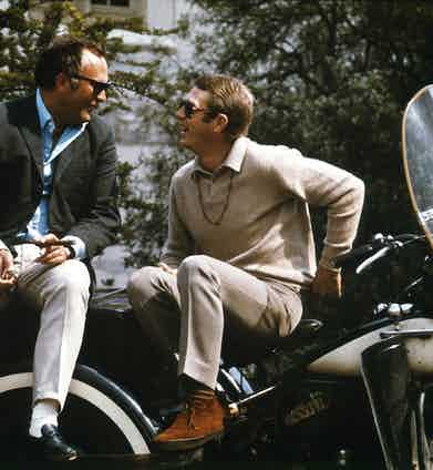 Steve McQueen pairs tones of ecru and beige, finished with tan suede Sanders & Sanders' chukka boots on the set of Bullitt, 1968.