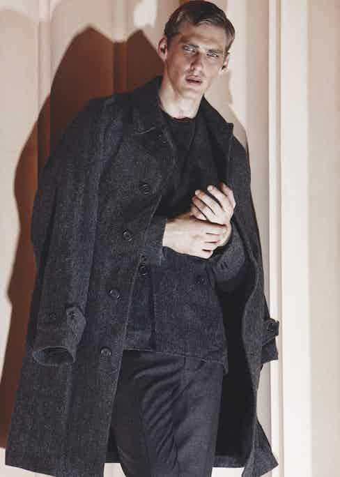 A charcoal grey wool two-piece with matching coat by Polo Ralph Lauren worn over a charcoal knitted jumper is less harsh than an all-black ensemble.