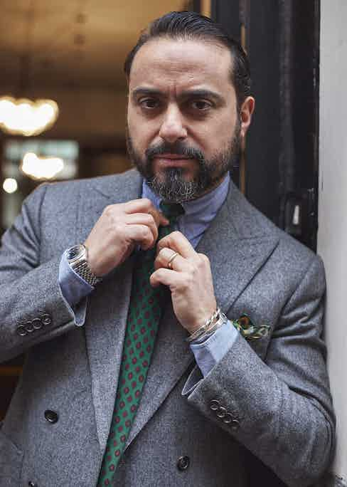 Salvatore adjusts his 40-year-old vintage printed silk tie that was given to him by Luigi Solito.