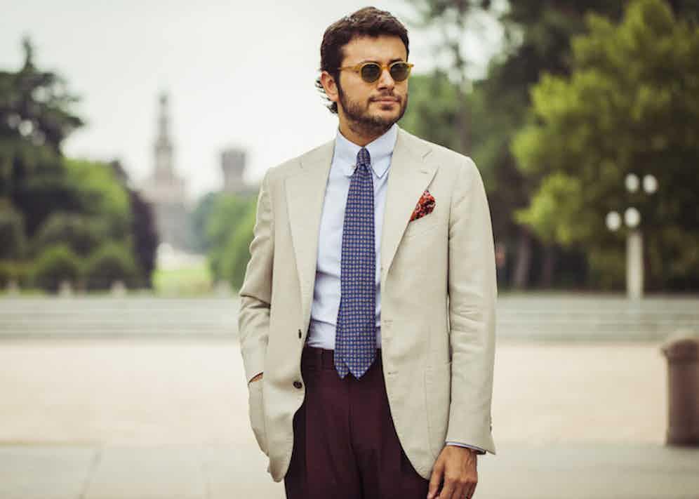 Fabio Attanasio wears a madder silk tie from Francesco Marino with a cream, three-roll-two jacket from Edesim Napoli Tailoring. Photograph by Eduardo Moruzzi.