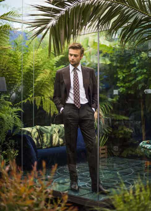 Douglas Booth wears a Francesco Marino tie with a double-breasted jacket from Turnbull & Asser, wool trousers from Ambrosi Napoli and brown lizard shoes from Berluti. Styled by Jo Grzeszczuk, photograph by Pip.