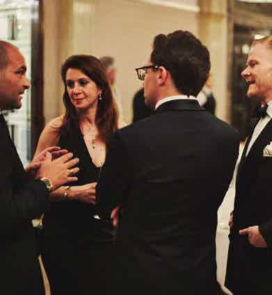 (Left) Salvatore Ambrosi of Ambrosi Napoli speaking with Paul Fournier and guests.