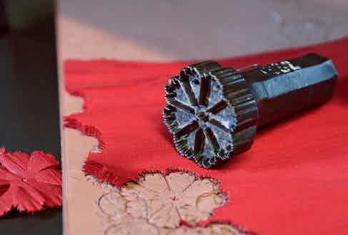 The cutting tool used to create the separate pieces of silk used for the lapel pins.