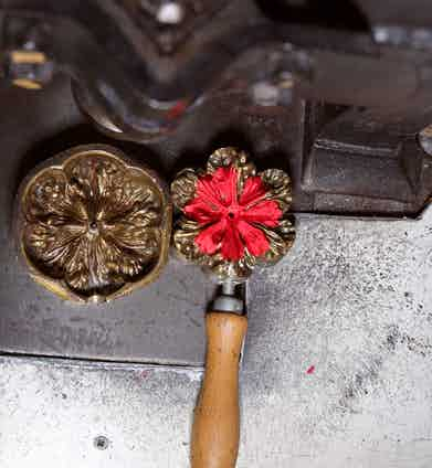 The silk after being pressed in the flower texture mould.