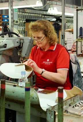 The base structure of a shoe is sewn at the new Grenson factory, a move made in 2013.