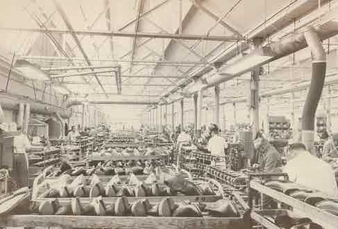 The original Grenson factory at work at the corner of Queen Street and Cromwell road in Rushden, Northamptonshire.