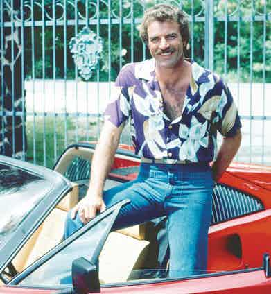 Tom Selleck as the titular investigator in the television series 'Magnum, P.I.', loved two things – his red Ferrari 308 and Hawaiian shirts. Pictured here on set, circa 1985. Photograph by Silver Screen Collection/Archive Photos/Getty Images.