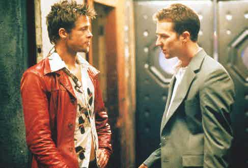 Brad Pitt pairs a camp collar Hawaiian shirt with a red leather jacket alongside Edward Norton in Fight Club, 1999. Photograph by Moviestore/REX/Shutterstock.