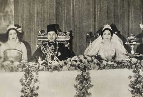 King Farouk at his wedding lunch to his first wife, Safinaz Zulficar.