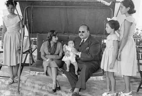 King Farouk pictured in exile with his family on the island of Capri, 1953.