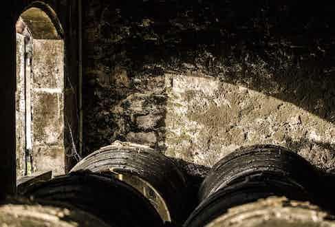Tierçon casks rest quietly inside the warehouses amid the grandiose confines of Le Grollet, Rémy Martin's family home.
