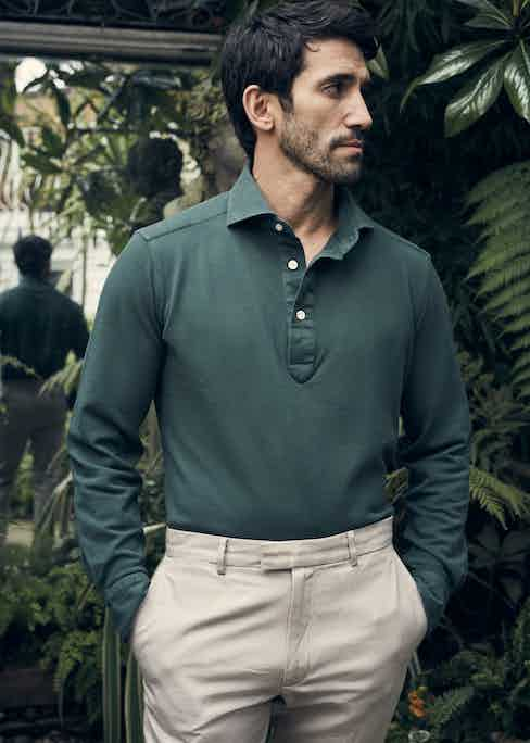 Forest green long sleeve polo shirt, Luca Avitabile; cream cotton trousers, Enlist. Styling by Jo Grzeszczuk, photograph by Olivier Barjolle.