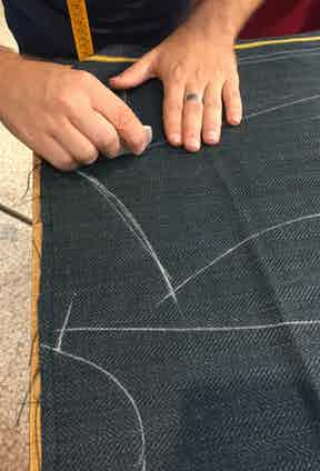 A jacket being marked out with tailor's chalk.