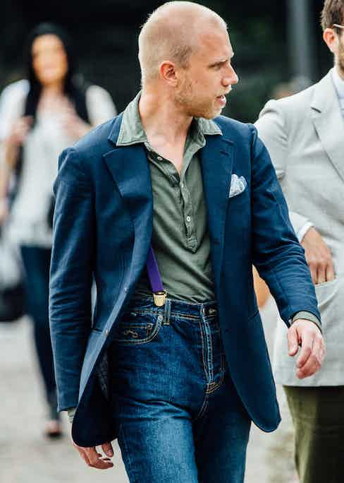 Tailor Robin Peterson wears high-rise jeans, complemented with braces, with an olive polo shirt beneath a soft structured blazer. A harmonious combination. Photo by Jamie Ferguson.