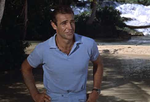 Sean Connery matches a light blue polo shirt with a pair of similar coloured shorts in Dr No., 1962.