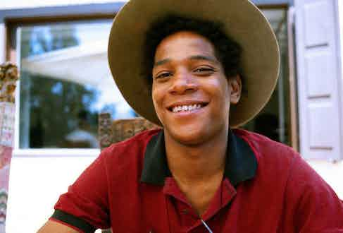 American artist Jean-Michel Basquiat gives the polo shirt an artistic edge in 1983.