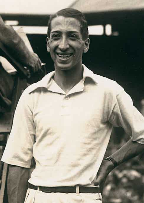 French tennis player René Lacoste wears an open-weave piqué cotton, soft-collared, three-button placket-front shirt at the Wimbledon Championships in London, 1927.