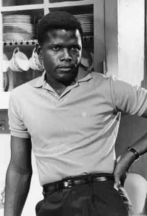 Sidney Poitier, who was the first black actor to win an Academy Award, sports a polo shirt tucked into his trousers.