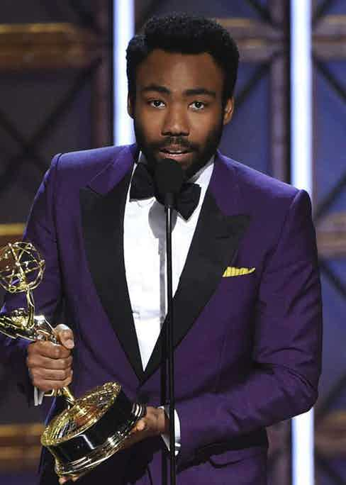 Donald Glover, pictured here at the Emmy Awards, wears a purple jacket with contrasting black lapels by Gucci. Photograph by Rex.