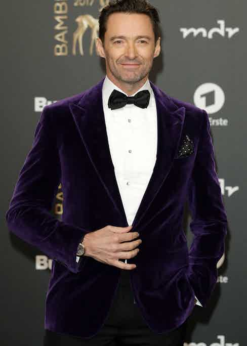 Hugh Jackman wears a purple velvet jacket by Ralph Lauren Purple Label to the 2017 BAMBI awards.