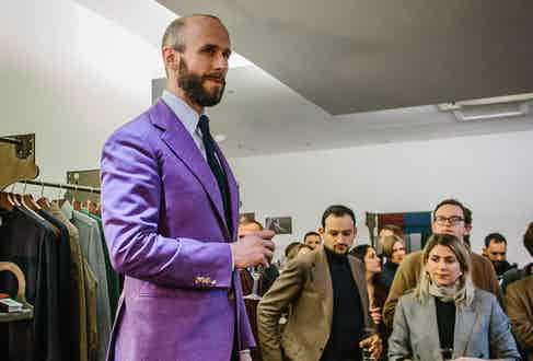 Simon Crompton wears a purple jacket by Liverano & Liverano at the opening of his Permanent Style Presents pop-up shop.