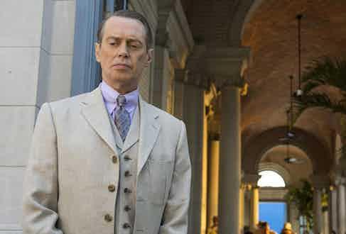 """Steve Buscemi, in character as Enoch """"Nucky"""" Thompson in Boardwalk Empire, wears a light purple shirt."""