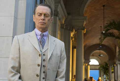 "Steve Buscemi, in character as Enoch ""Nucky"" Thompson in Boardwalk Empire, wears a light purple shirt."