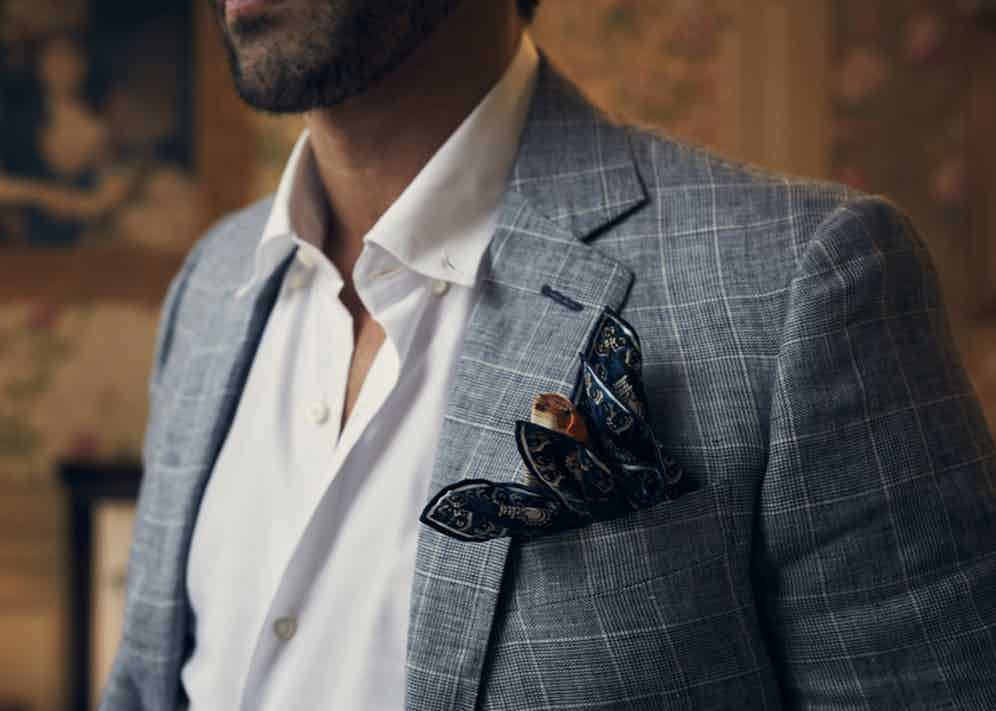 Blue checked linen jacket, Richard James; white cotton button-down shirt, Ign. Joseph; Queen Victoria coronation silk pocket square, Rampley & Co. Styling by Jo Grzeszczuk, photograph by Olivier Barjolle.