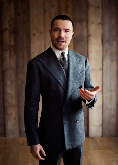 Charcoal grey wool double-breasted jacket and trousers, Dalcuore; ivory cotton shirt, Edward Sexton; grey silk printed vintage tie, property of The Rake.