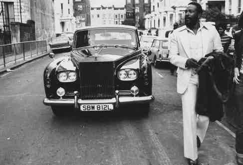 Gaye walking ahead of his Rolls Royce in Notting Hill, London in 1976. Photograph by John Minihan/Evening Standard/Getty Images.
