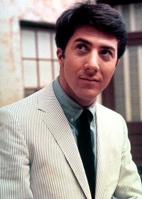 Dustin Hoffman wears a traditional seersucker jacket, paired with a button-down denim shirt and a black tie in 'The Graduate', 1967.